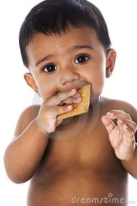 sweet-indian-baby-eating-cookie-13880613