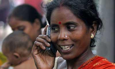 Slum-dweller-uses-mobile