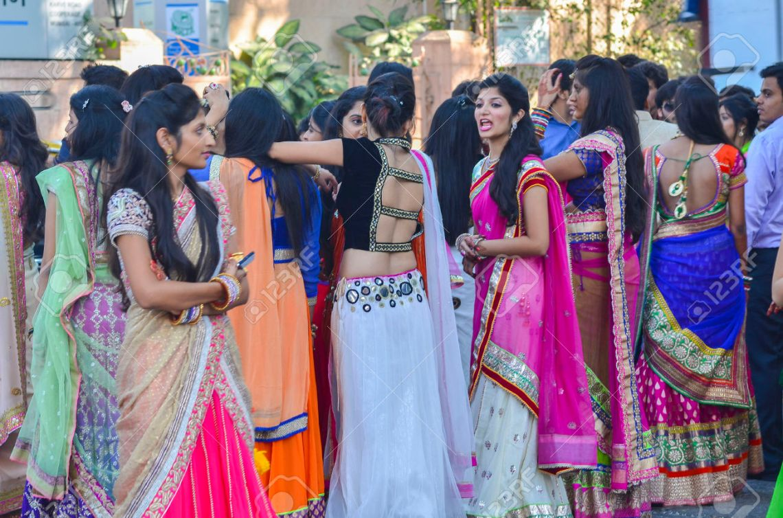 26419482-Mumbai-India-January-18-2014-people-dressing-in-colorful-traditional-dresses-gathering-at-the-weddin-Stock-Photo